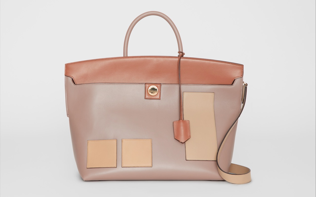 95f09c7911fc Contrast panels and polished lock and key give this bag a refined finish