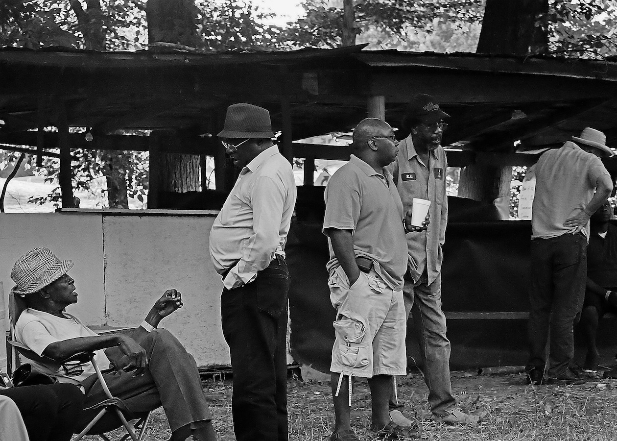 RL and friends waiting for their turns to play at a yard party held at Otha Turner's old homestead in Gravel Springs, Mississippi.