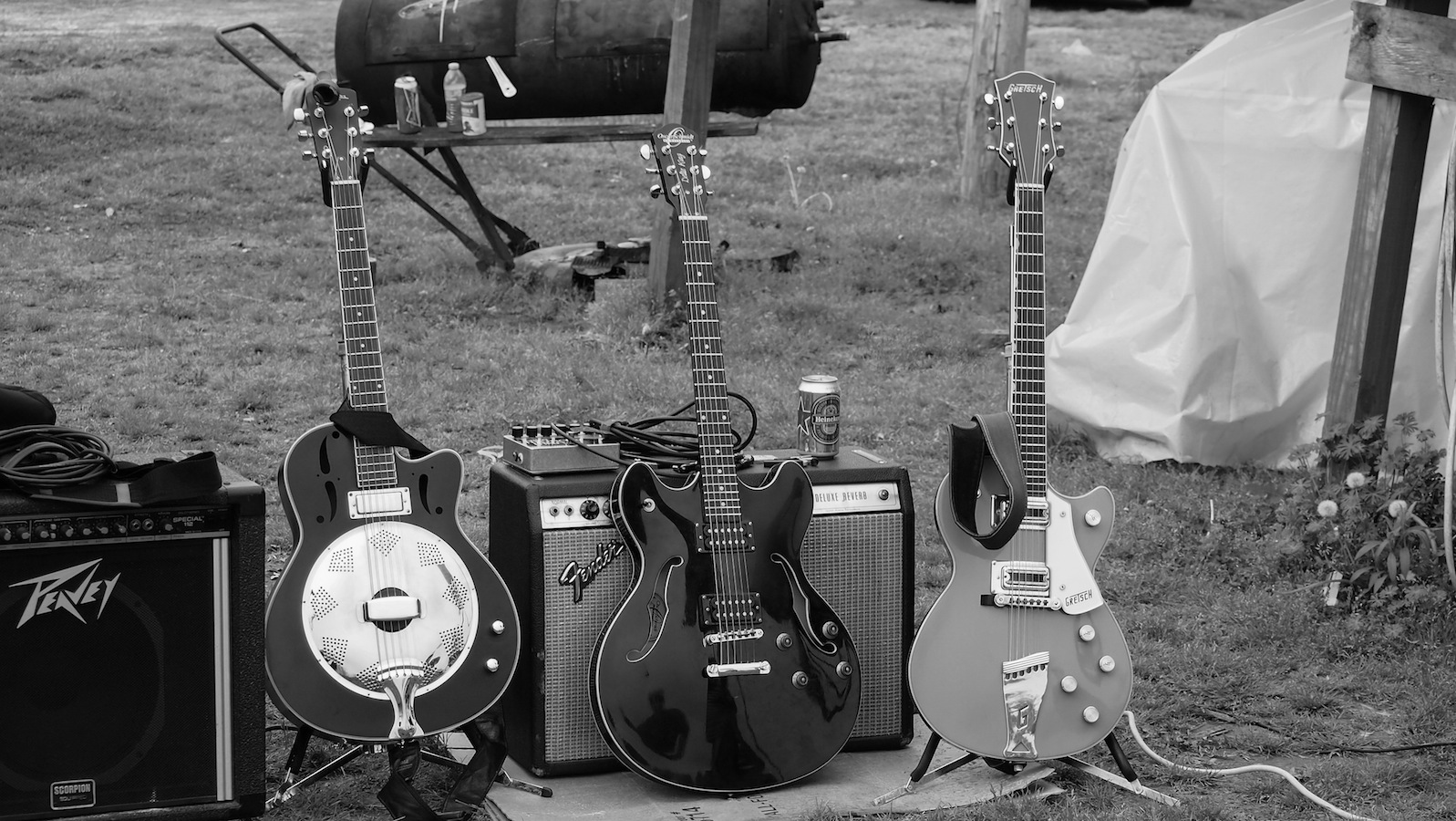 RL's nephew, Joon, had a trailer on land back in the woods just outside Como, Mississippi.  Joon's yard was a common spot for RL to set up and hold hill country blues parties.  Here's RL's guitar (middle) waiting to be played.