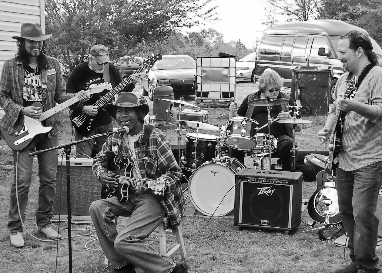 RL's nephew, Joon, had a trailer on land back in the woods just outside Como, Mississippi.  Joon's yard was a common spot for RL to set up and hold hill country blues parties. Here RL plays with his sometimes backing band The Cornlickers.