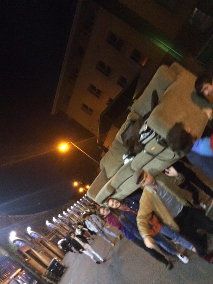 Here's a bunch of our friends carrying a couch outside The Poetry Club.